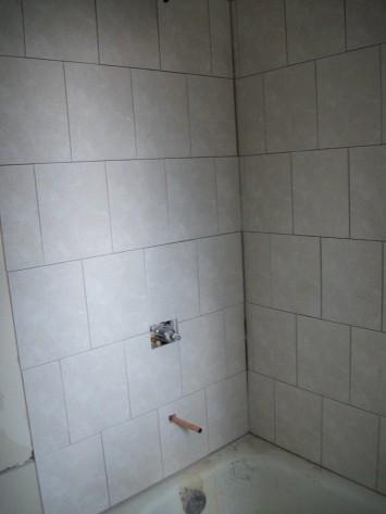 APT 4- BATH TILE INSTALL/ PLUMBING